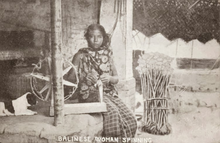 Description: Balinese woman and her spinning wheel