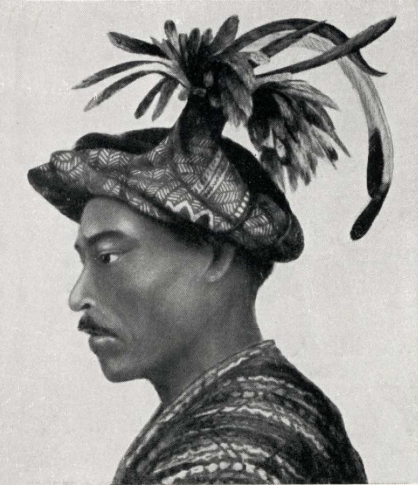 Description: A man from Kisar with a chicken feather headdress 1955-1975