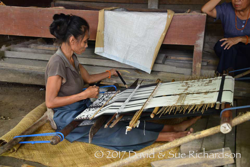 Description: Passing the weft