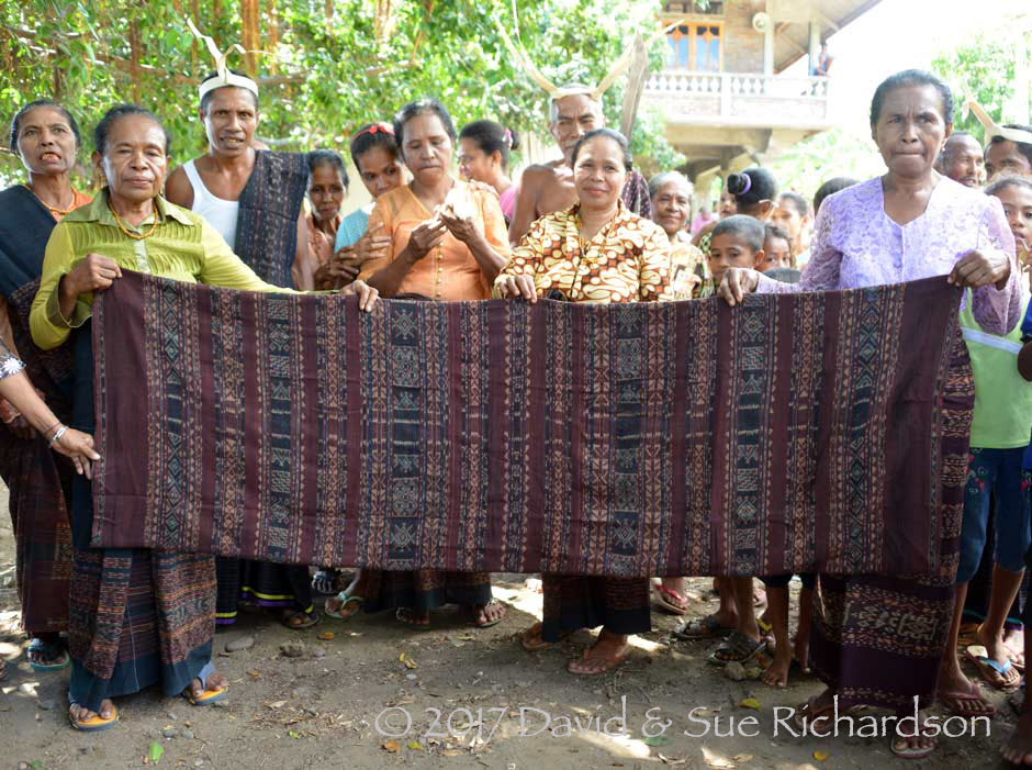 Description: villagers with an heirloom textile
