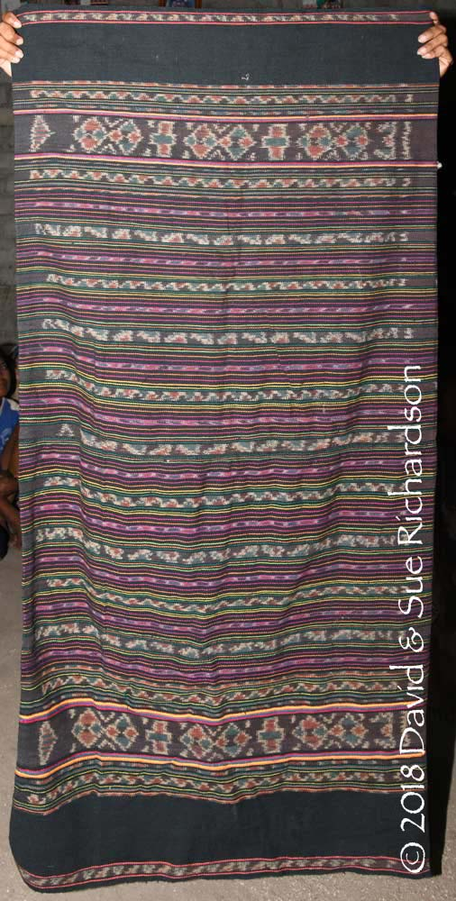 Description: A 'tenapi matang kari' woven in Uma Pura