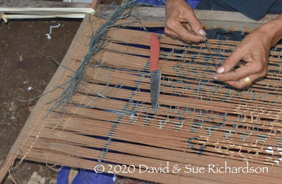 Description: The narrow woven section of warps and the grouping of the bundles into ikat bands